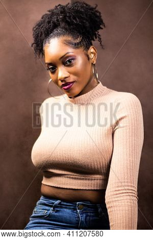 Woman With Natural Hair Wears Earrings And Sweater