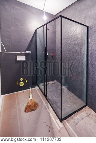 A Bathroom Construction In Progress, With Wall Mounted Toilet Installation And Shower Cabin