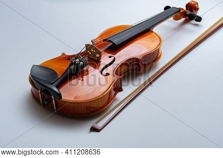 Bow And Violin Isolated On White Musical Wood
