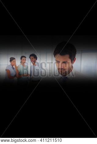 Caucasian businessman with diverse colleagues talking secretively in background seen through slit. workplace politics concept, digitally generated image.