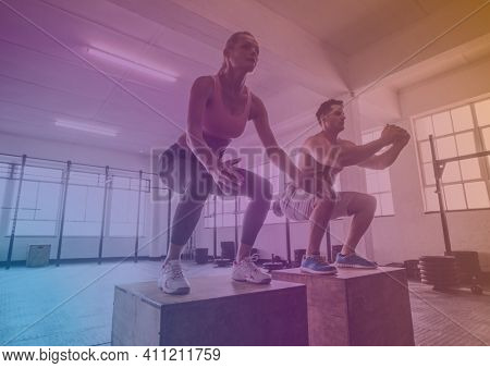 Man and woman exercising in gym with gradient overlay. fitness and healthy lifestyle concept digitally generated image.