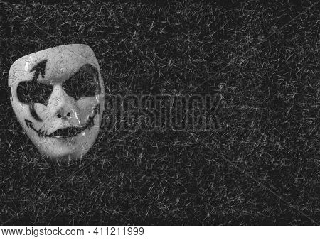 Carnival face mask on grey background with white strokes. carnival party concept digitally generated image.
