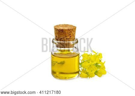 Oil Mustard In A Vial With Flower