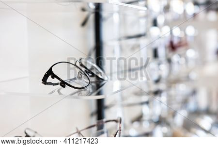 Selective Focus At Glasses Frame On The Shelf Inside Of The Store For Customer Choice And Selection.