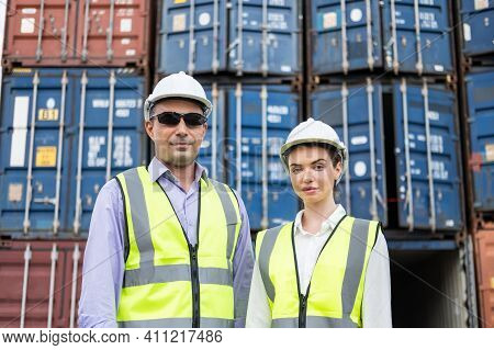 Caucasian Men And Women Freight  Supervisor Wearing Safety Vest And Hat While Inspect Condition Of A