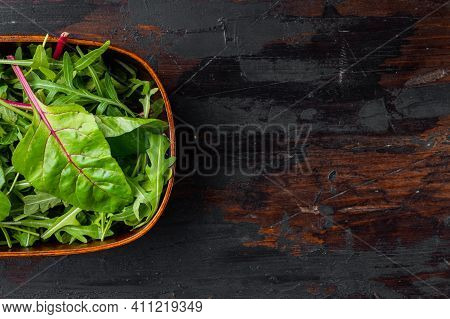 Arugula Raab And Mangold, Swiss Chard, On Old Dark  Wooden Table Background, Top View Flat Lay, With
