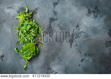 Herb Green Salad With Arugula And Mangold, Swiss Chard Set, On Gray Stone Background, Top View Flat