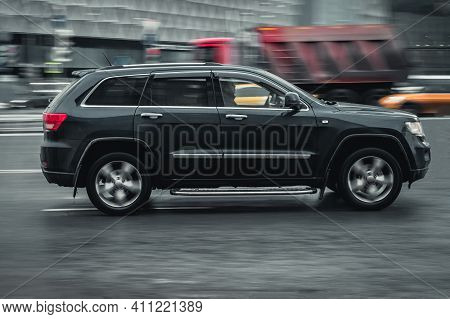 Moscow, Russia - 29.01.2021: Jeep Grand Cherokee Driving On Wet City Road On High Speed. 4x4 Suv In
