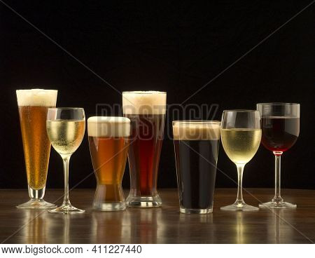 Alcohol. Glass With An Alcoholic Drink. Bottles Of Alcohol.