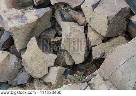 Top View Of Pile Of Crushed Big Basalt Stones In Quarry. Building Raw Materials.
