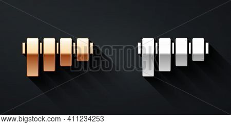 Gold And Silver Pan Flute Icon Isolated On Black Background. Traditional Peruvian Musical Instrument