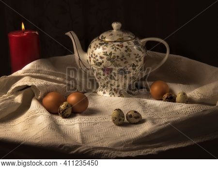 Antique Vintage Teacup, Quail And Chicken Eggs On The Table Concept