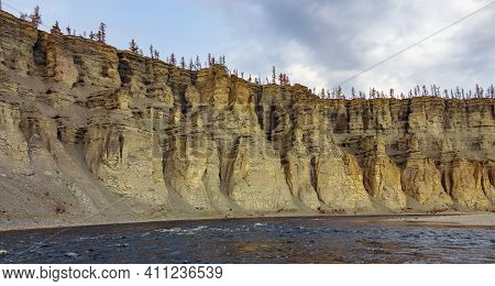 Landscape With A Rocky Steep Bank On The North River. Rocks Of The Siberian River Canyon On An Autum