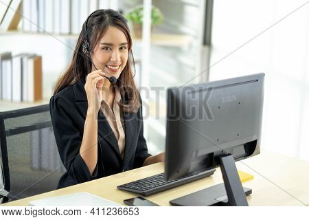 Portrait Of Happy Smiling Female Customer Support Phone Operator At Workplace. Professional Operator