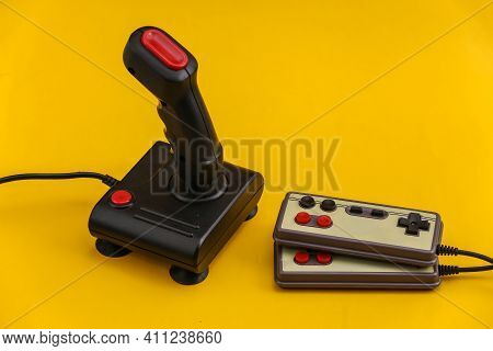 Retro Gamepads And Joystick On Yellow Background. Video Game, Gaming 80s.