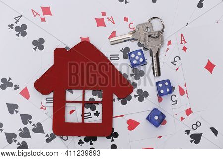 House Figure And Keys, Dice On Playing Cards. Everything Is At Stake