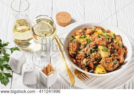 Conejo Al Ajillo, Braised Rabbit With Potatoes, Garlic, White Wine, Salt, And Olive Oil, Spanish Cui