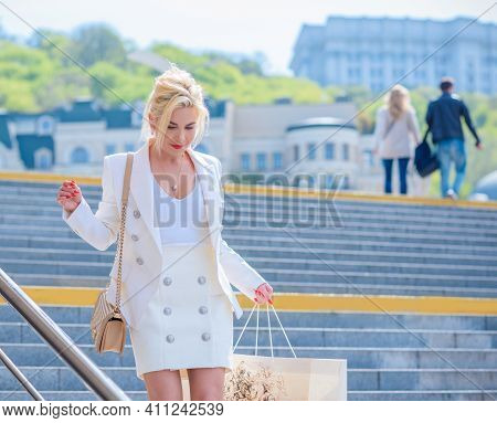 Woman In White Jacket And Skirt At Street, Woman Outfit. Business And Fancy Style For Ladies, Fashio