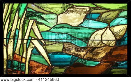 BENEDIKTBEUERN, GERMANY - OCTOBER 19, 2014: View the elements of life, detail of stained glass window by Sieger Koder in Benediktbeuern Abbey, Germany