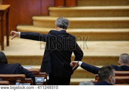Bucharest, Romania - March 02, 2021: Romanian Members Of Parliament Gesture To Their Colleagues How