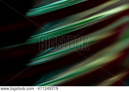 Abstract Photo Image Background Of Glossy Rounded Objects With Black Shadow, A Luster That Gives A S