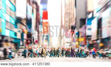 Defocused Background Of People Walking On Zebra Crossing On 7th Avenue In Manhattan - Crowded Street