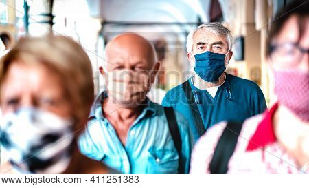 Urban Crowd Of Adult Citizens Walking On City Street During Pandemic - New Reality Life Style Concep