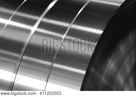 Aluminum Strips Wound On Coils, Industrial Background Photo In Black And White