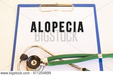 Alopecia- Text On Medical Folder With Documents And Stethoscope On White Background. Medical Concept
