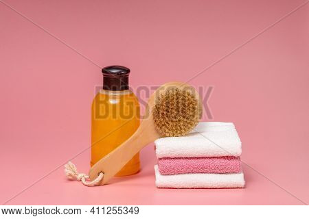 Flat Lay Composition With Spa Cosmetics And Towel On Pink Background