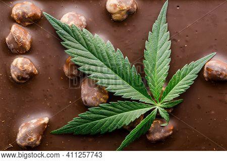 Marijuana Leaf And Chocolate.cbd Cannabis Chocolate With Whole Nuts Edibles, Marijuana Leaf. Chocola