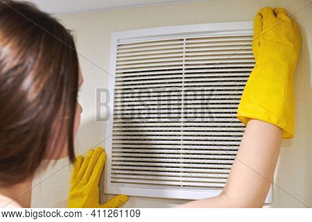Hands In Protective Rubber Gloves Opening Clogged Air Ventilation Grill Of Hvac With Dusty Filter To