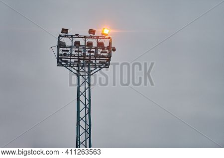Security Watchtower For Observing. Viewing Tower With Spotlights On Evening Sky Background, Copy Spa