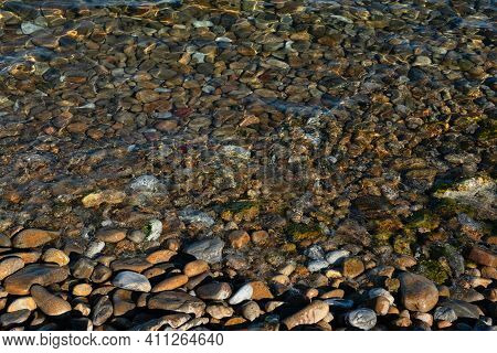 Clean Water And Stony Bottom Of The Baikal Lake At Summer Sunny Day. Concept Of Relaxation, Nature.