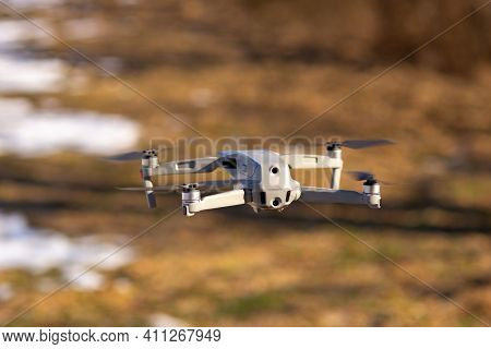 Drone, Quadcopter In Flight. In The Air. The Quadcopter Is Flying. Drone Camera. Drone In Nature. Sh