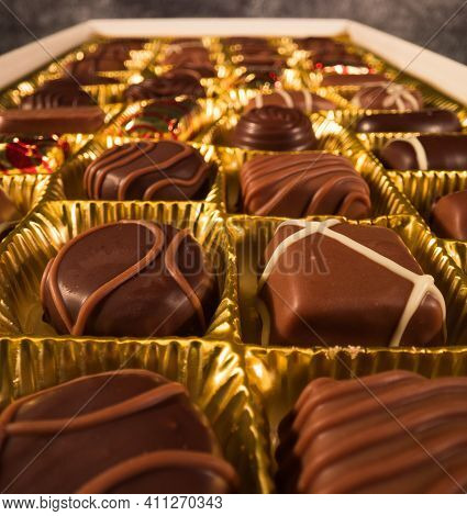 Chocolate Pralines In Close-up View - Macro Sliding Shot - Food Photography