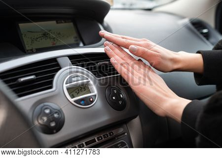 A Woman Holds Her Hands Cold Over A Car Heater. It Warms Your Hands With Warm Air.
