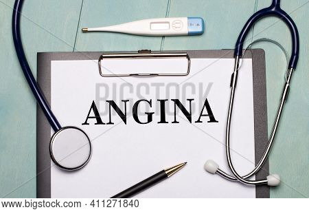 On A Light Blue Wooden Background, There Is A Paper Labeled Angina, A Stethoscope, An Electronic The
