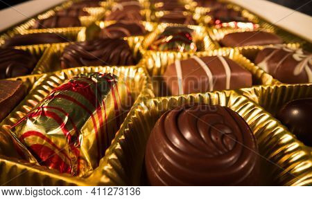 A Box Of Chocolates Pralines In Close-up View - Food Photography