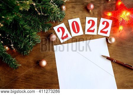 Wish List On A Wooden Background With The Numbers 2021, A Blank Sheet Of Paper And A Pen For Writing
