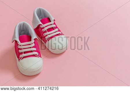 Baby Girl Shoes On Pastel Pink Color Background, Closeup View