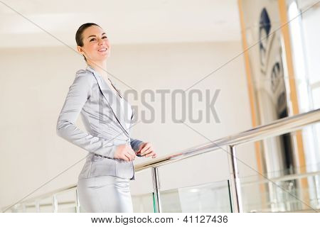 Business woman standing in the lobby of the office