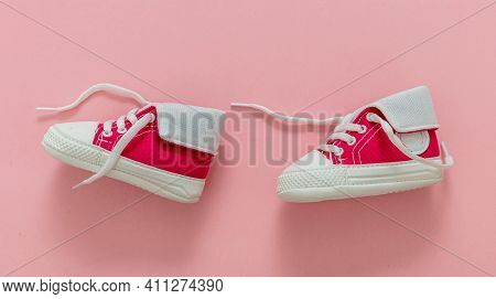 Baby Girl Shoes On Pastel Pink Color Background, Closeup