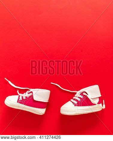 Baby Shoes On Blue Color Background, Copy Space