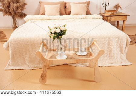 Beautiful Beige Brown White Bedroom. Fashion Design, Pampas, Bed Tray Table Flowers Of Plants, Candl
