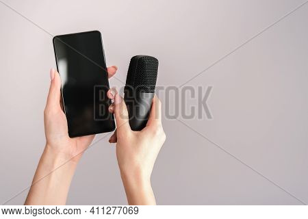 Concept For Clubhouse Drop-in Audio Is A Voice-activated Social Media App. Smartphone And Microphone