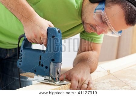 Man Working Wood With Electric Saw