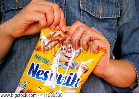Tambov, Russian Federation - January 30, 2021 Woman Hands Ready To Open Nesquik Candies Pack