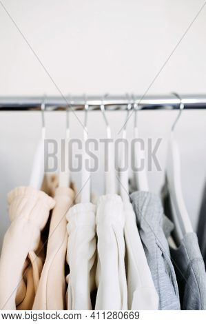 Circular Economy, Second Hand, Fast Fashion, Sustainable Fashion. Many Second Hand Clothes Hanged On
