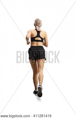 Full length rear shot of a woman in sportswear running isolated on white background